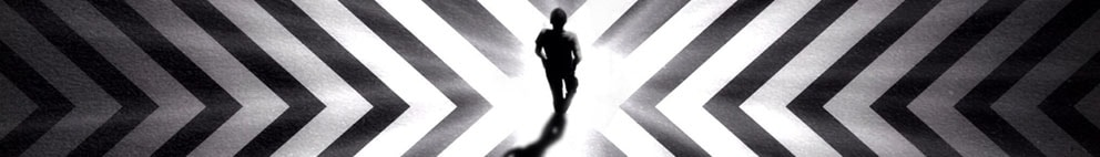 man walking in middle of black and white floor